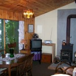 Another view of dining area. Airtight stove (firewood provided) TV, DVD, radio.
