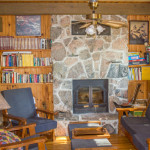 Comfortable living room. New cushions on couch and chairs. Elevated knotty pine ceilings and walls. Fireplaces. TV/DVD