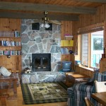 Comfortable living room. Elevated knotty pine ceilings and walls. Fireplaces. TV/DVD