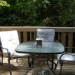 Pine entrance deck with outdoor patio dining furniture.