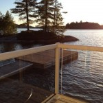 Deck of boathouse/bunkie overlooks little island and miles of lake, facing NW for terrific sunsets!