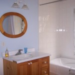 4-piece bathroom with Jacuzzi. Big window over tub allows a peaceful view of the forest.