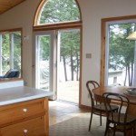 Dining room and living room look out over lake. A walk-out to deck. Lots of windows welcome in the great outdoors. Patio table &amp; chairs for outdoor dining. Propane BBQ.