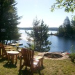 Nestled in a quiet bay behind an island, enjoy the lakeside fire pit. Southern exposure for all day sun and terrific sunsets.