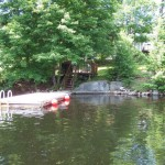 Large floating dock. Deep water swimming. Note lookout deck