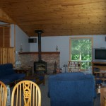Spacious, open concept living room & dining room. Vaulted pine ceilings. Satellite TV/DVD. High efficiency woodstove.