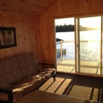 Newly renovated boathouse - a pine-finished bunkie right on the water! -- with futon, bar, stools, balcony / deck.