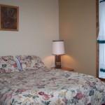 4th (main floor) bedroom.  Queen bed.