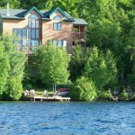 Moose Haven from the lake.  Late Spring shoreline. By mid August a 6-8 foot beach in front of cabin.