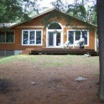 Welcome to Lynne's Hideaway -- a secluded 6 acre lakeside retreat. Property gently slopes to the lake. Note screened-in porch.
