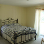 Large master bedroom with walk-out to balcony. Lots of closet space.