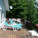 Large sunny deck. Lots of lounge furniture
