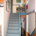 Stairs to upper and rear entrance