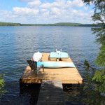 The floating dock in a small bay affords a wonderful view of the lake. Cottage comes with a kayak, paddleboat and a surfboard