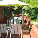 Large, sunny deck with plenty of space for outdoor dining and entertainment. Propane BBQ