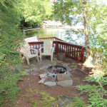 Safely enclosed lakeside fire pit