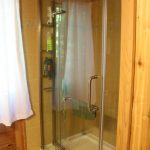 1 ample sized bathroom with shower