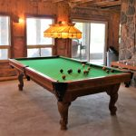 Pool table downstairs with walkout to lower deck