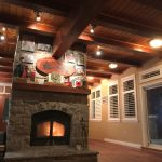 This high efficiency stone fireplace is replicated downstairs too for year-round comfort