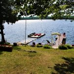Cottage is situated 40 feet from shore on a level lot