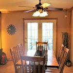 French doors lead from dining area to front deck