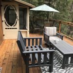 Sturdy deck furniture and outdoor dining set. Note screened room.
