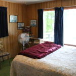 Bunkie, first bedroom: double and set of bunks. Games. Upper deck overlooks lake
