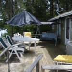 Deck has umbrella, lounge chairs and cushions