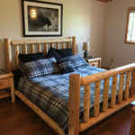 18' x 12' master bedroom, with king bed and woodstove