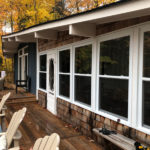 Wrap around deck with lounge set and Muskoka chairs (late Fall pic)
