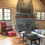 Floor to ceiling stone fireplace.