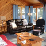 Sunken pine-finished living room. Walkout to large deck
